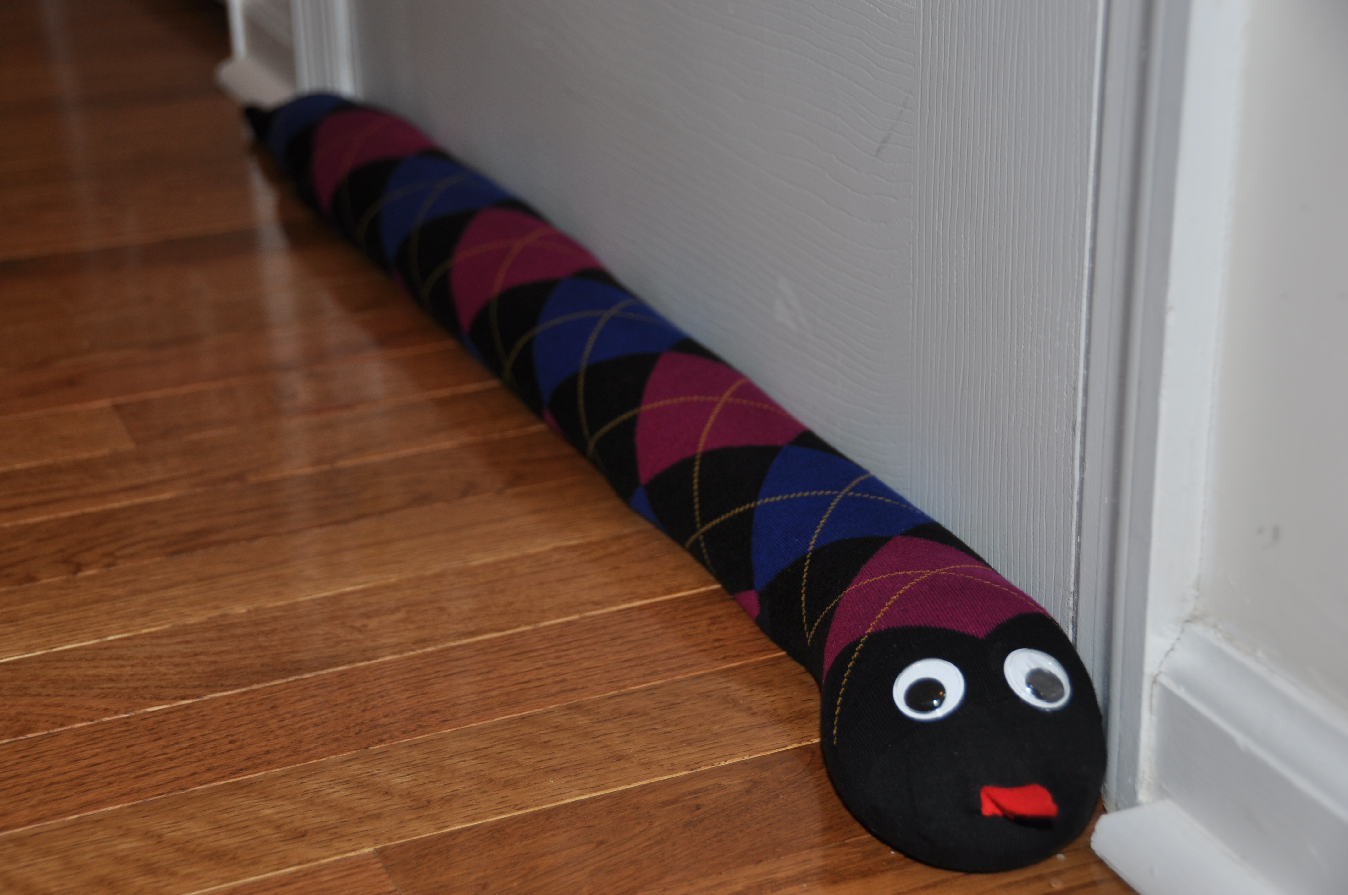 Door draft stoppers, aka draft snakes, can save money on heating bills, as well as reduce pollution. See examples of the cutest draft snakes around from crafty people.
